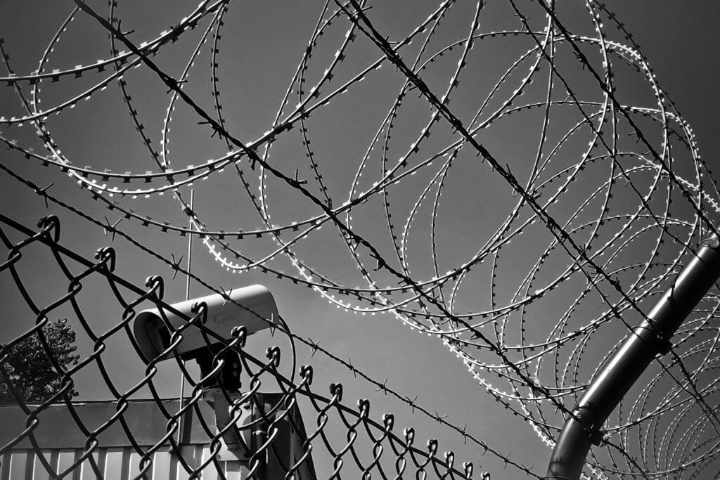 Image of a chain link fence and barbed wire
